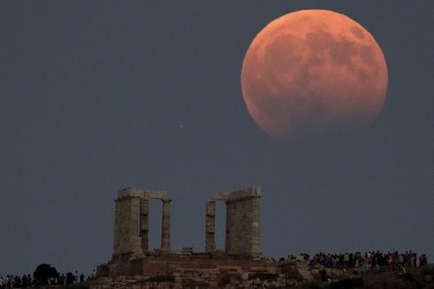 Stargazers view a lunar eclipse