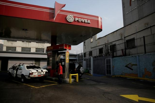 FILE PHOTO: The corporate logo of the state oil company PDVSA is seen at a gas station in Caracas, Venezuela April 12, 2017. Picture taken April 12, 2017. REUTERS/Marco Bello/File Photo