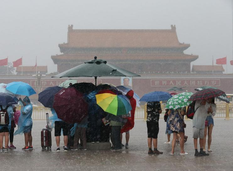 Storms disrupt Beijing flights, authorities warn of flash floods, landslides