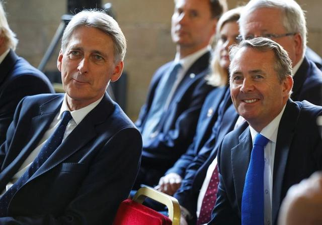 FILE PHOTO - Britain's Chancellor of the Exchequer Philip Hammond and Secretary of State for International Trade Liam Fox attend Prime Minister Theresa May's election manifesto launch in Halifax, May 18, 2017. REUTERS/Phil Noble