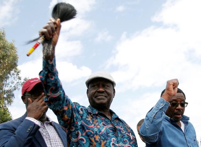 Opposition leader Raila Odinga greets supporters in the Kibera slum, Nairobi, Kenya August 13, 2017. REUTERS/Thomas Mukoya
