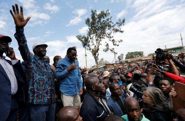 Opposition leader Raila Odinga addresses supporters in Kibera slum, Nairobi, Kenya, August 13, 2017. REUTERS/Thomas Mukoya