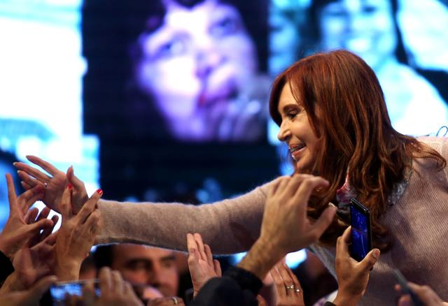 Cristina Fernandez de Kirchner, former Argentine President and candidate for the Senate in the mid-term primary elections, greets supporters at her campaign headquarters in Buenos Aires, Argentina early August 14, 2017.  REUTERS/Marcos Brindicci