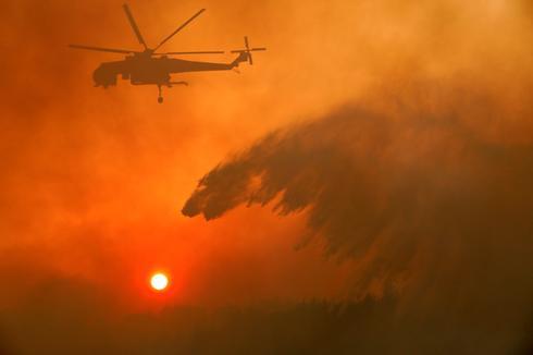 Blazes burn across Greece