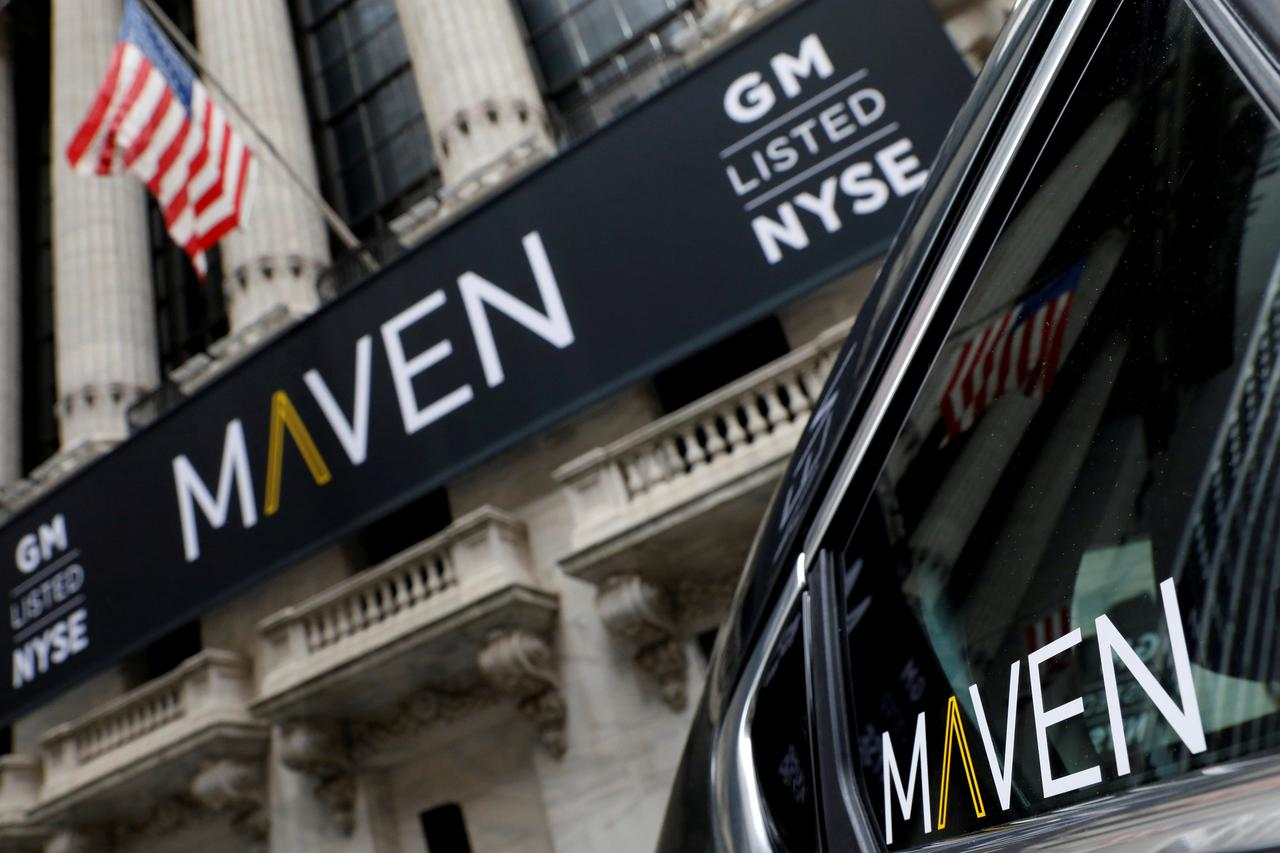 FILE PHOTO: A sign for General Motors Co. car-sharing operation, Maven hangs on the facade of the New York Stock Exchange (NYSE) in New York, U.S., May 15, ...