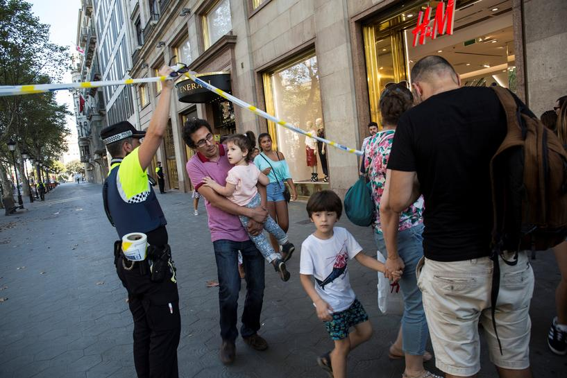Van plows through crowd in Barcelona, killing at least 13