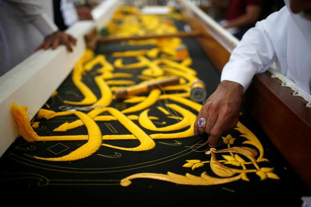 Saudi factory stitches gold-laced cover for Islam's holiest site ...