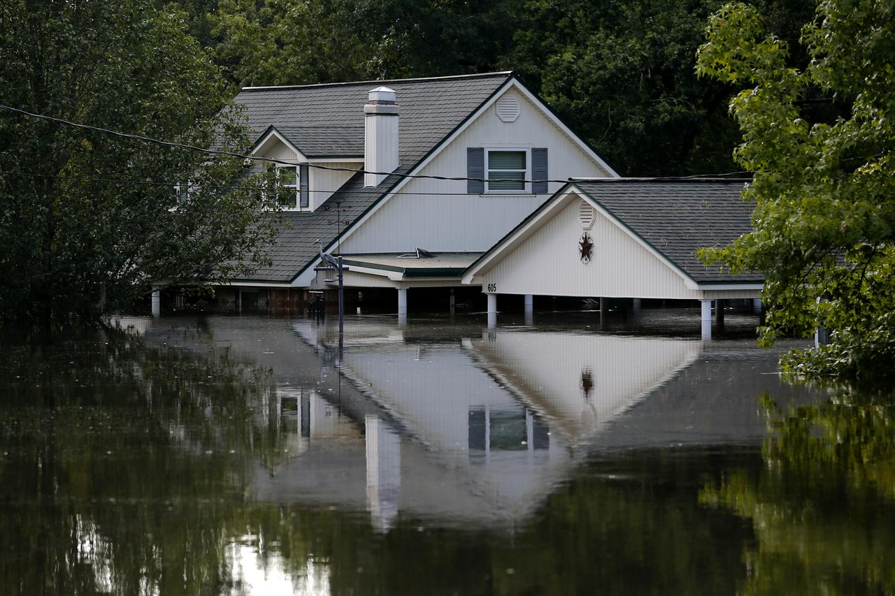 Harvey residential insured and uninsured flood loss 25 37 a submerged house by flood waters from tropical storm harvey in rose city texas us on august 31 2017 reutersjonathan bachman buycottarizona