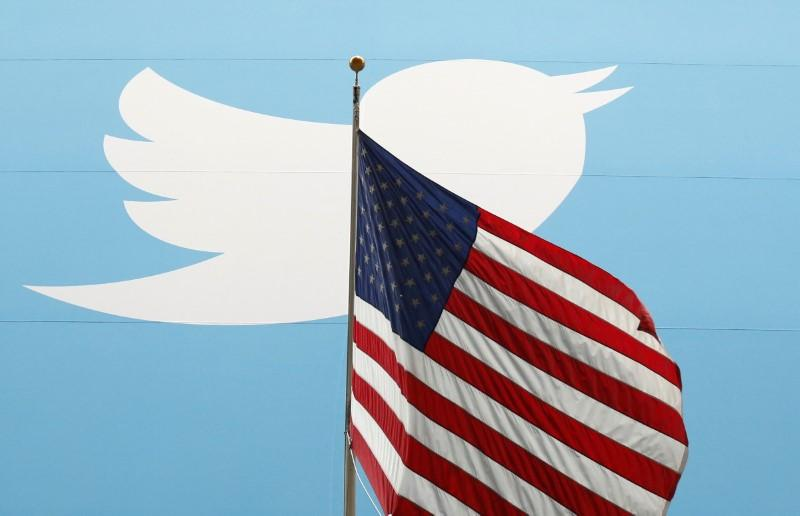The Twitter Inc. logo is shown with the U.S. flag during the company's IPO on the floor of the New York Stock Exchange in New York, November 7, 2013.    Lucas Jackson