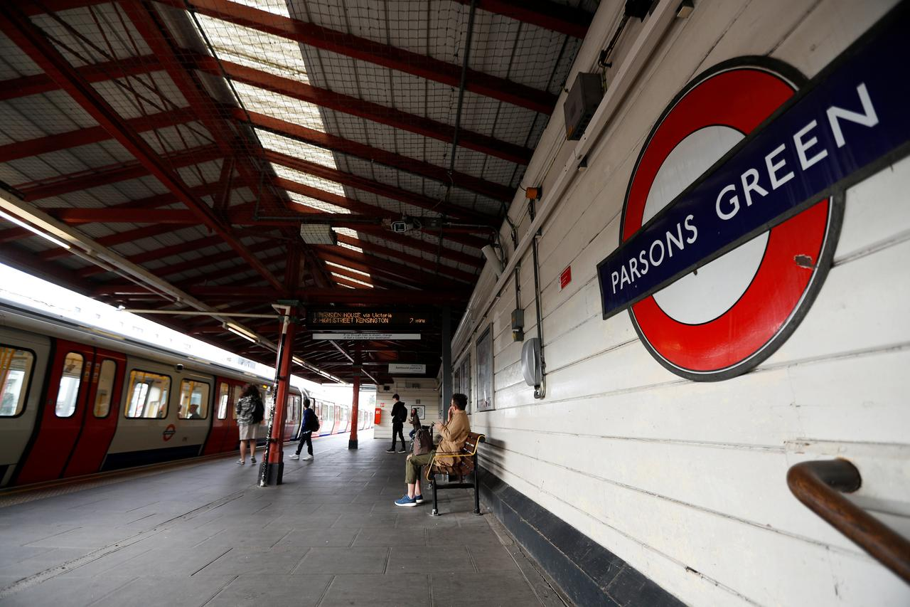 British police arrest seventh man over bomb attack on London train