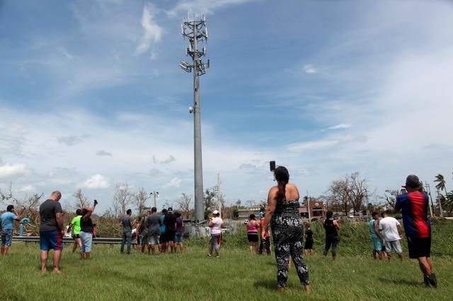 With cell service crippled, Puerto Ricans look skyward for a