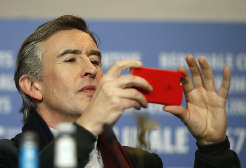 British actor Coogan wins damages over phone-hacking - Reuters