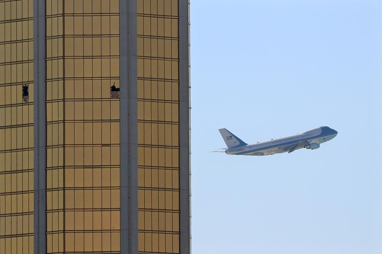 Air Force One departs Las Vegas past the broken windows on the Mandalay Bay hotel, where shooter Stephen Paddock conducted his mass shooting along the Las Vegas Strip in Las Vegas, Nevada. REUTERS/Mike Blake