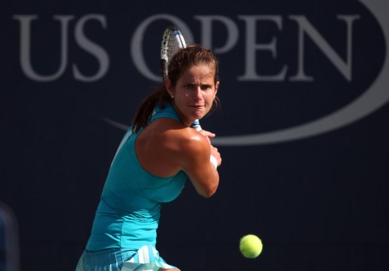 Julia Goerges of Germany returns a shot to Aleksandra Krunic of Serbia on  day five of