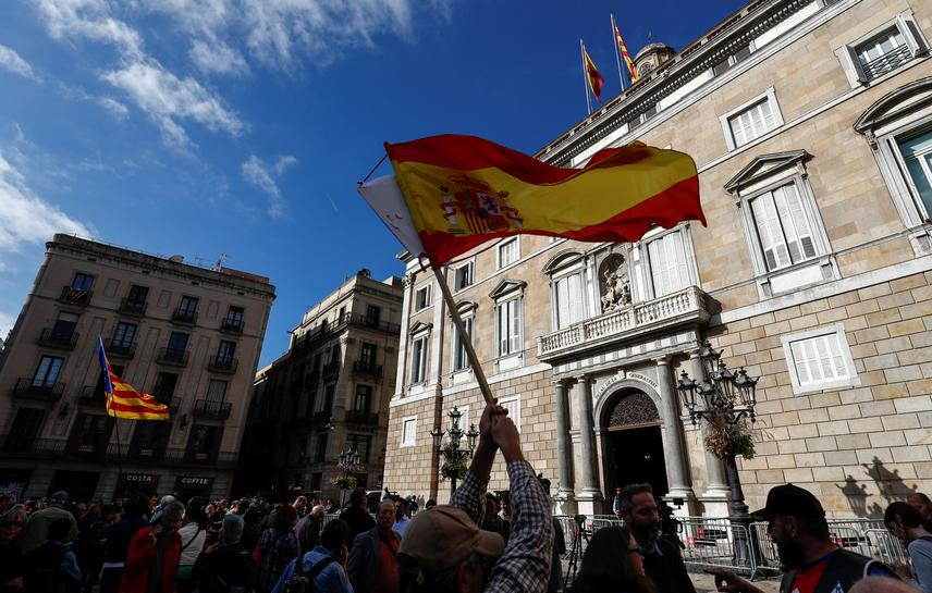Spain's direct rule takes hold in Catalonia as secessionists accept elections