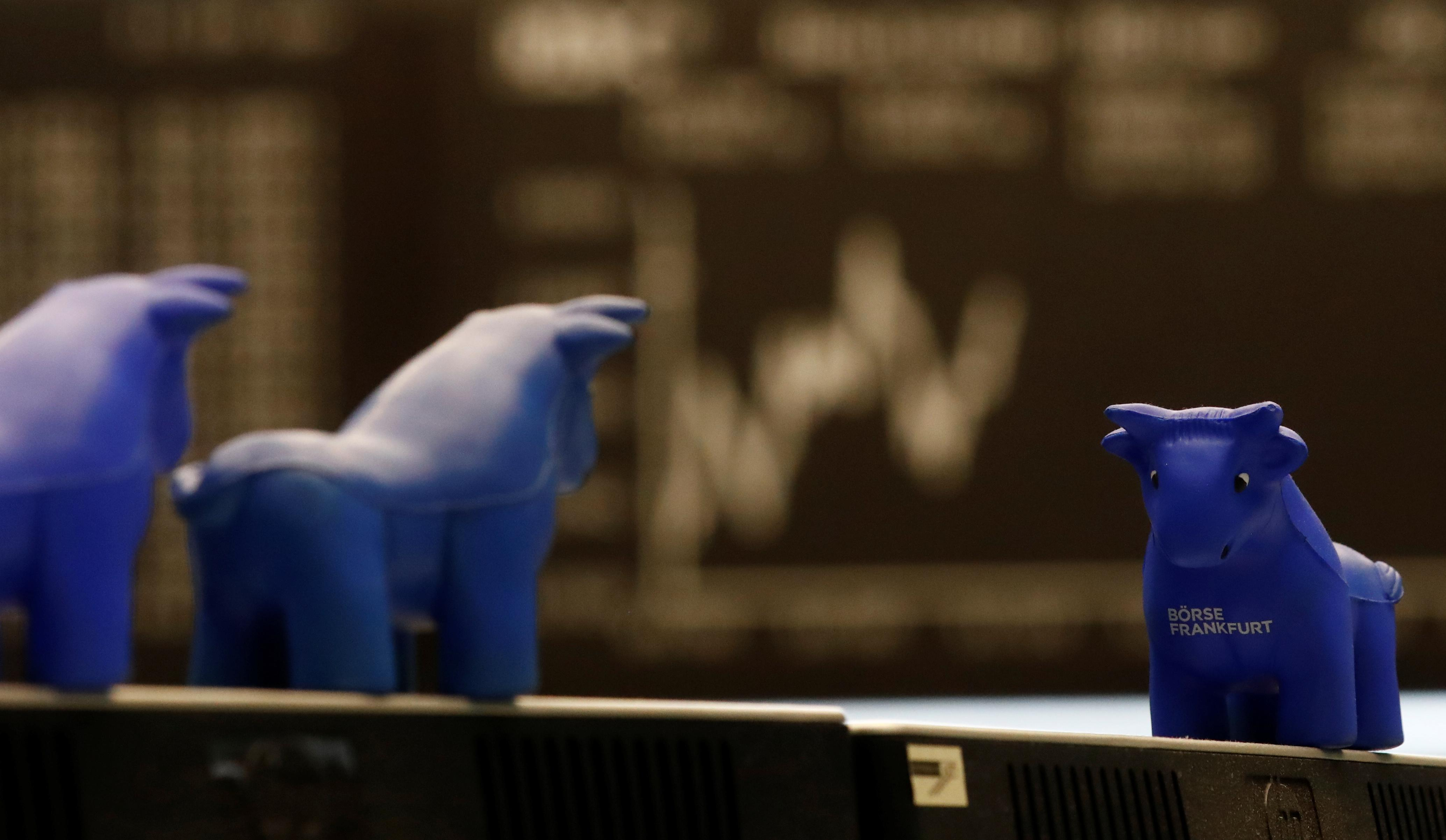 A plastic bull figurine, symbol of the Frankfurt stock exchange is pictured in front of the share price index DAX board at the stock exchange in Frankfurt, Germany, November 20, 2017.    Kai Pfaffenbach