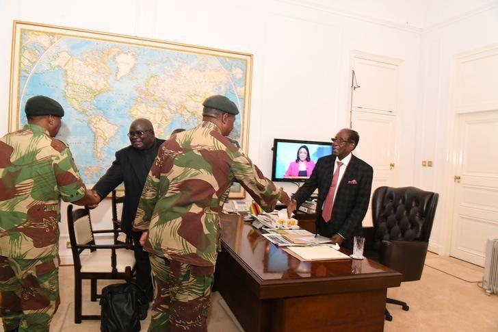 Zimbabwe's President Robert Mugabe meets with senior members of the Zimbabwe Defence Forces and police at State House in Harare, Zimbabwe November 19, 2017. ZIMPAPERS IMAGES/Joseph Nyadzayo/Handout via