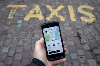FILE PHOTO:    A photo illustration shows the Uber app on a mobile...