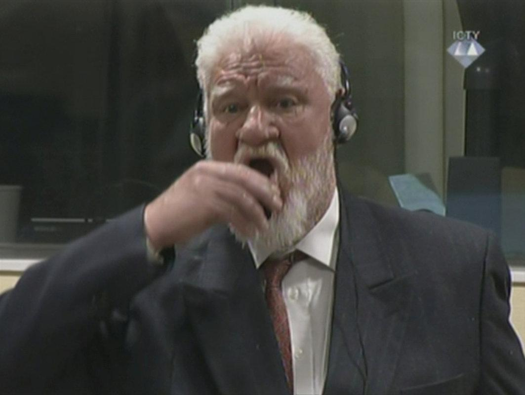 Bosnian Croat war crimes convict dies after taking 'poison' in U.N. court