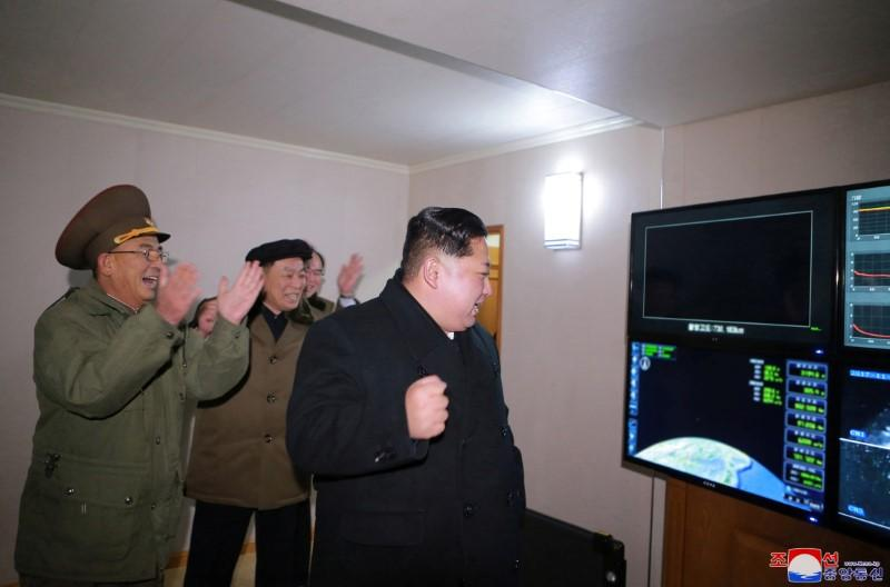 83c4fde472f North Korea s leader Kim Jong Un is seen as the newly developed  intercontinental ballistic rocket Hwasong-15 s test was successfully  launched