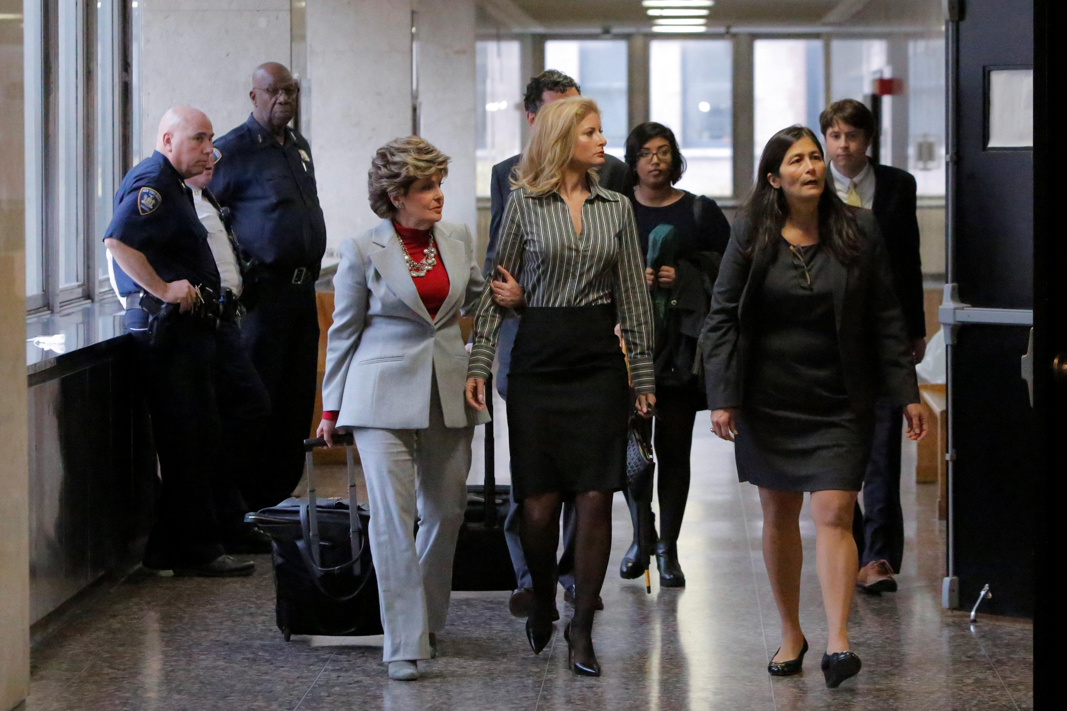 Summer Zervos (C), a former contestant on The Apprentice, arrives at New York State Supreme Court with attorney Gloria Allred (L) as a judge considers throwing out a defamation case against U.S. President Donald Trump in Manhattan, New York City, U.S., December 5, 2017. Andrew Kelly