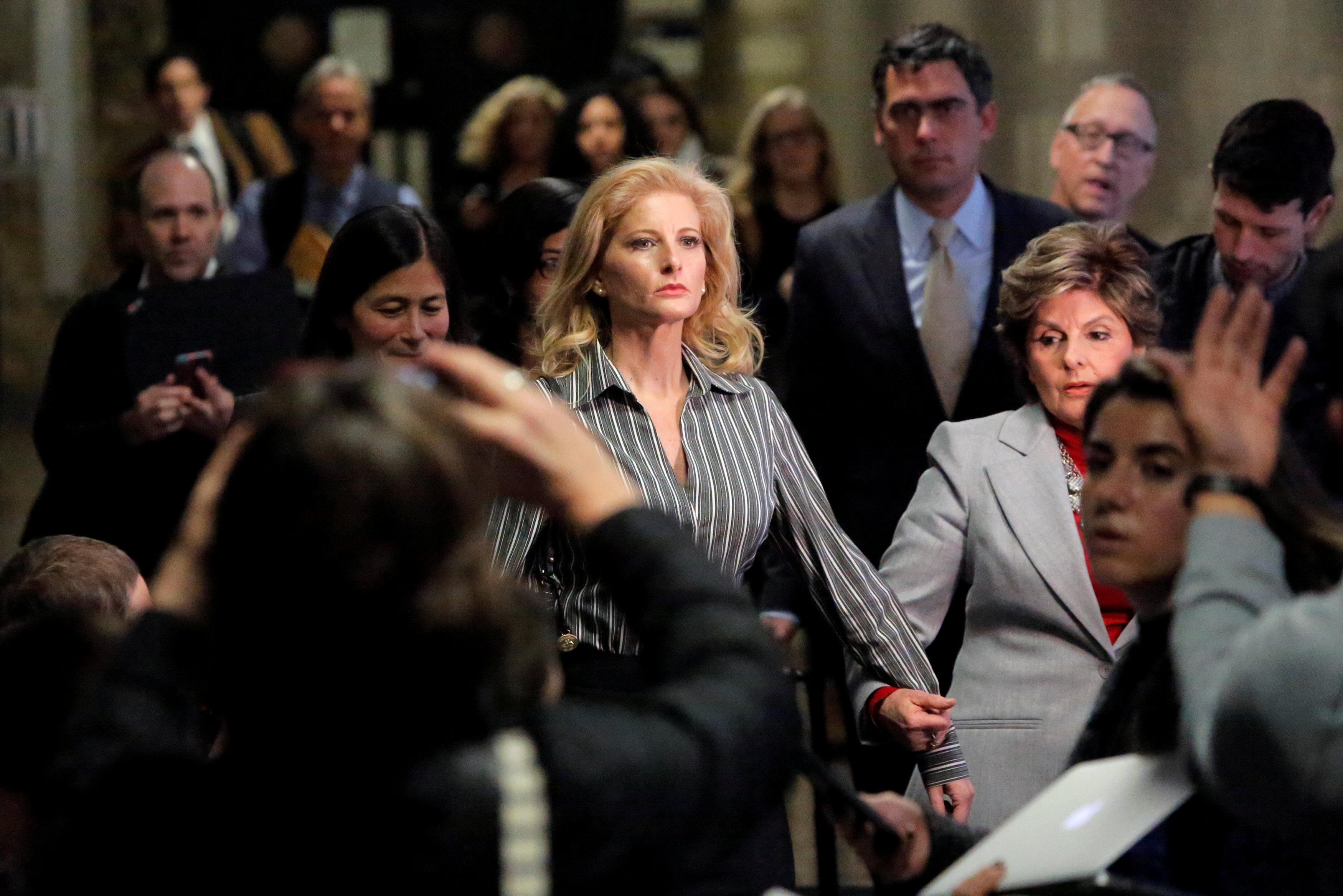 Summer Zervos, a former contestant on The Apprentice, leaves New York State Supreme Court with attorney Gloria Allred (R) after a hearing on the defamation case against U.S. President Donald Trump in Manhattan, New York City, U.S., December 5, 2017.  Andrew Kelly