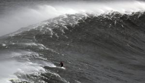 Surfing giant waves in Portugal