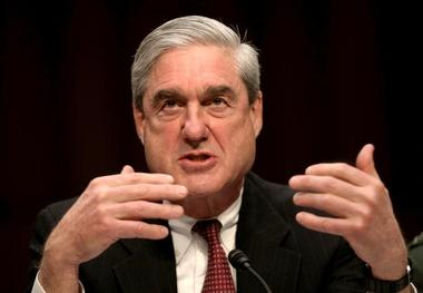 FILE PHOTO - Then FBI Director Robert Mueller testifies at a Senate...