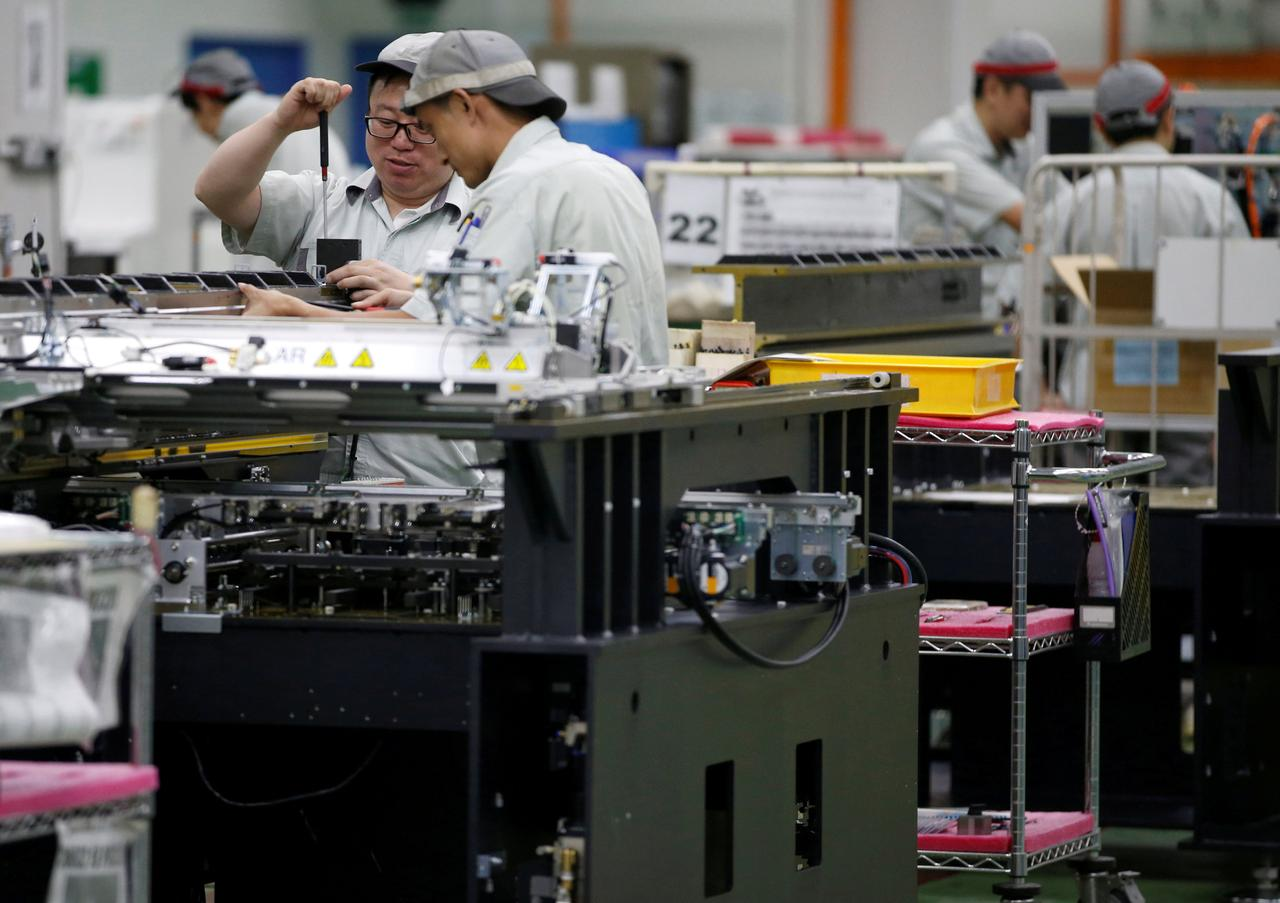 Singapore Fourth Quarter Gdp Growth Seen Slowing From Blistering Electronic Assembly Jobs Circuit Board File Photo Employees Are By Their Workstations At A Printed Factory In June 28 2016 Reuters Edgar Su