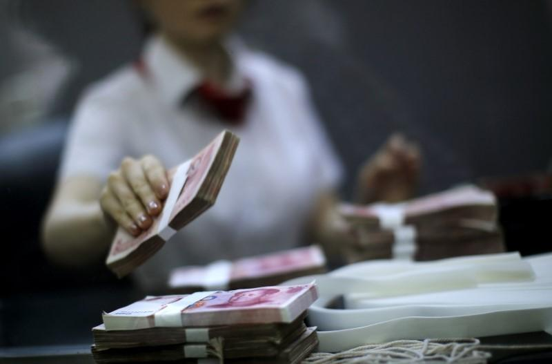 China to cap overseas withdrawals using domestic bank cards  4911d6b6651