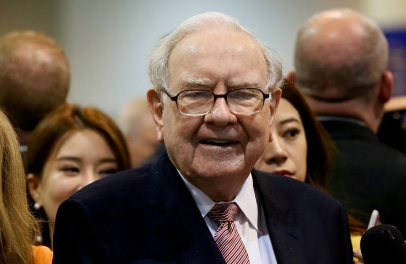 warren buffett proclaims optimism for america s financial future file photo berkshire hathaway ceo warren buffett s the bnsf booth before the berkshire hathaway annual meeting in omaha nebraska u s 6 2017