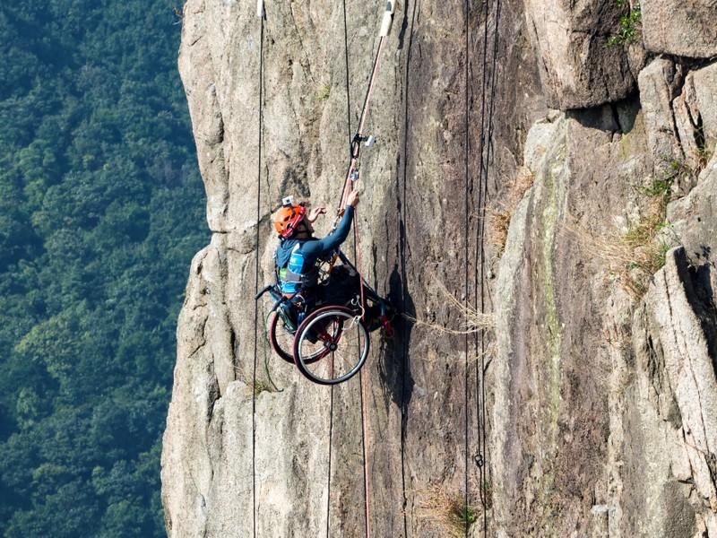 wheelchair bound athlete honored for climbing up mountain reuters