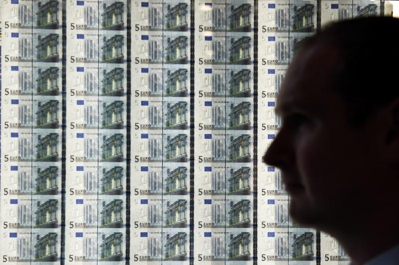 A Man Is Seen In Front Of Sheet Five Euro Notes At The Opening New Central Bank Ireland Offices Dublin April 24 2017