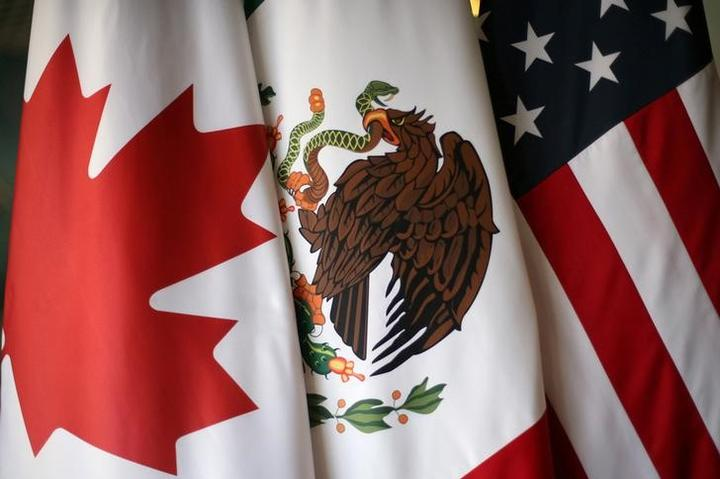 FILE PHOTO: Flags are pictured during the fifth round of NAFTA talks...