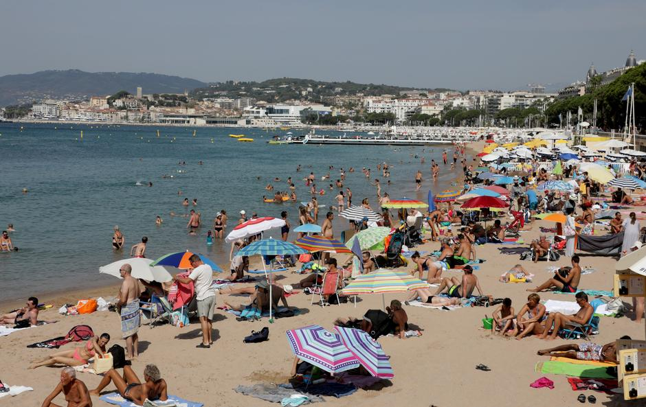 File Photo People Enjoy The Sun On A Croisette Beach In Cannes France August 1 2017 Reuters Eric Gaillard