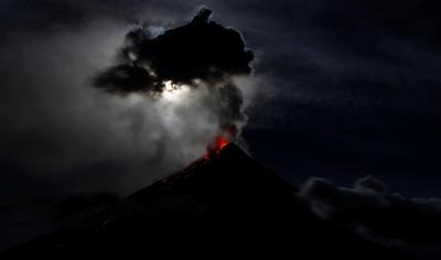 Thousands flee erupting volcano