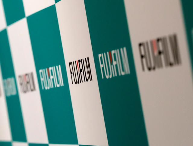 Fujifilm Holdings' logos are pictured ahead of its news conference in Tokyo, Japan January 31, 2018. REUTERS/Kim Kyung-Hoon