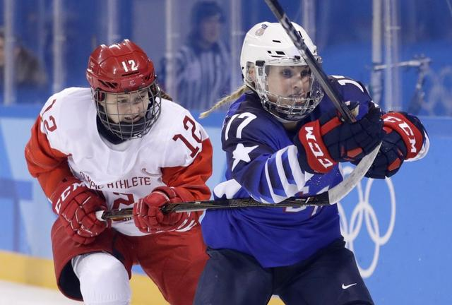 Ice Hockey – Pyeongchang 2018 Winter Olympics – Women Preliminary Round Match - U.S. v Olympic Athletes from Russia - Kwandong Hockey Centre, Gangneung, South Korea – February 13, 2018 - Yekaterina Lobova, an Olympic athlete from Russia, and Jocelyne Lamoureux-Davidson of the U.S. in action. REUTERS/David W Cerny