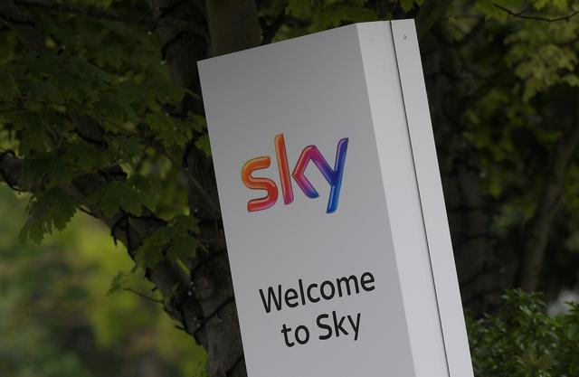 FILE PHOTO: The Sky logo is seen on outside of an entrance to offices and studios in west London, Britain June 29, 2017. REUTERS/Toby Melville/File Photo