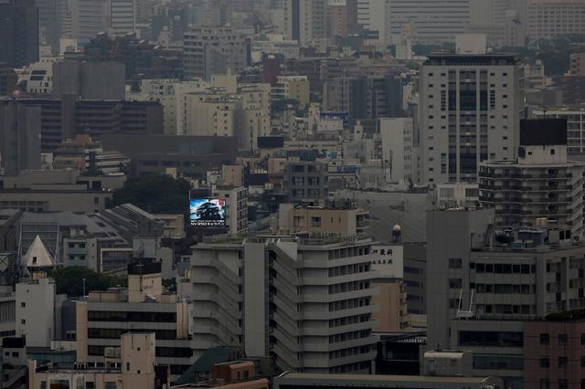 FILE PHOTO: A billboard advertising a car is seen in central Tokyo, Japan June 7, 2016.  REUTERS/Toru Hanai/File Photo
