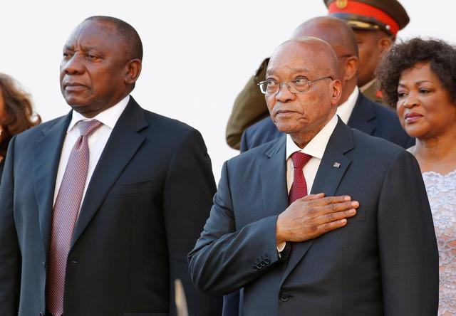 24d4fe9dbc9 FILE PHOTO  South Africa s Deputy President Cyril Ramaphosa and President  Jacob Zuma stand during the playing of the national anthem at the opening  of ...
