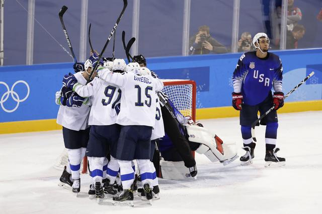 Ice Hockey – Pyeongchang 2018 Winter Olympics – Men Preliminary Round Match - U.S. v Slovenia - Kwandong Hockey Centre, Gangneung, South Korea – February 14, 2018 -  Slovenia celebrates their second goal as Jordan Greenway (R) of the U.S. looks up. REUTERS/David W Cerny