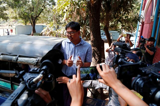 Detained Reuters journalist Wa Lone talks to reporters as he leaves after a court hearing in Yangon, Myanmar February 14, 2018. REUTERS/Stringer