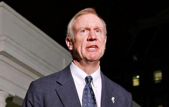FILE PHOTO: Illinois Gov-elect Bruce Rauner speaks to the media after a meeting with U.S. President Barack Obama and other Governor-elects from seven U.S. states at the White House in Washington, DC on December 5, 2014.        REUTERS/Larry Downing/File Photo