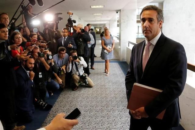 FILE PHOTO: Michael Cohen, personal attorney for U.S. President Donald Trump, talks to reporters as he departs after meeting with Senate Intelligence Committee staff on Capitol Hill in Washington, U.S. September 19, 2017. REUTERS/Jonathan Ernst