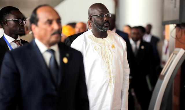 FILE PHOTO: Liberia's President George Weah arrives at the 30th Ordinary Session of the Assembly of the Heads of State and the Government of the African Union in Addis Ababa, Ethiopia January 28, 2018. REUTERS/Tiksa Negeri