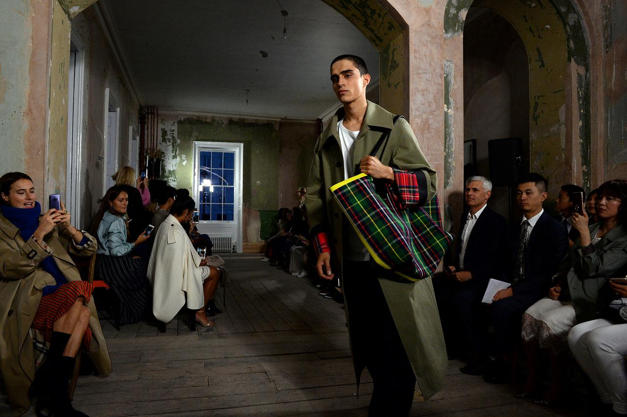 256263ba676bb Britain's Burberry pairs up with Farfetch in online push - Reuters