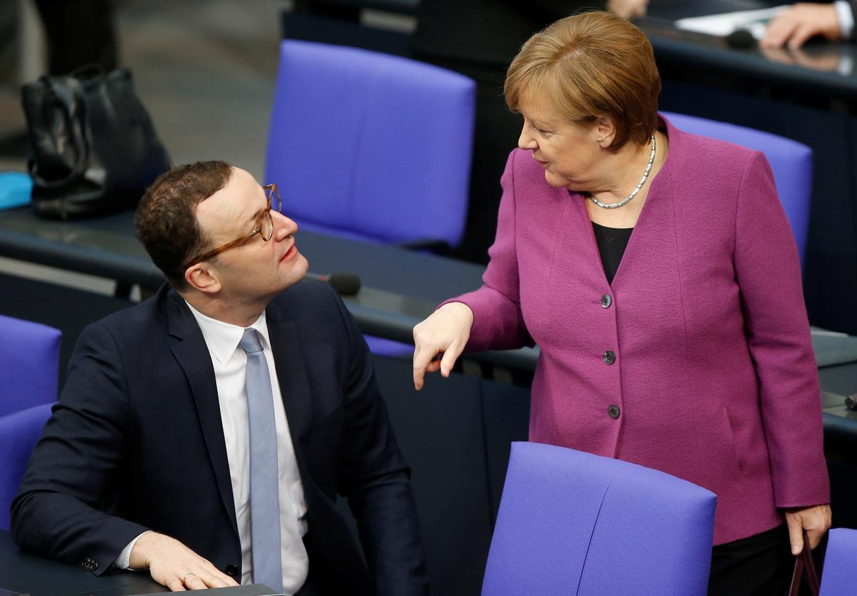 Weakened Merkel offers job to arch critic in young new German cabinet