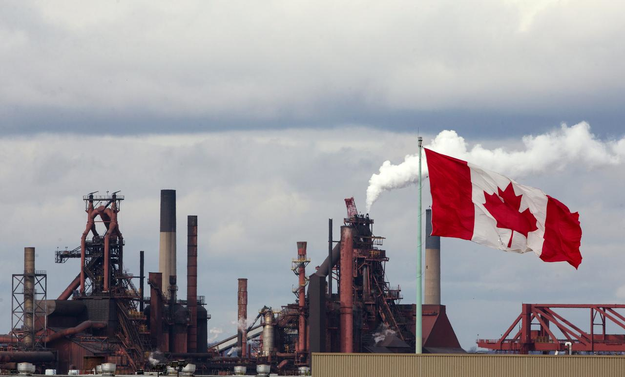 Arcelormittal canada operations not seeking canada government aid file photo a canadian flag flies above another industry site with arcelormittal dofasco in the background in hamilton ontario canada march 9 2018 buycottarizona
