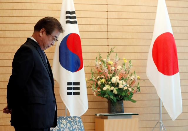 South Korea's National Intelligence Service chief Suh Hoon waits for arrival of Japan's Prime Minister Shinzo Abe prior to their meeting in Tokyo, Japan March 13, 2018. Picture taken March 13, 2018. REUTERS/Kim Kyung-Hoon/Pool
